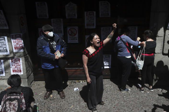 """Protesters gather outside the residence of former Mexican President Luis Echeverría, (1970-1976), during a march to commemorate the 50th anniversary of the student massacre of 1971 known as """"El Halconazo,"""" in Mexico City, Thursday, June 10, 2021. The attack, also known as the Corpus Christi massacre, was carried out by a group of men apparently recruited by the government to dissolve a pro-democracy student demonstration. (AP Photo/Marco Ugarte)"""