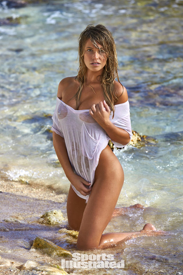 "<p>Samantha Hoopes was photographed by Ben Watts in Curacao. Top by <a href=""http://www.anrdoezrs.net/links/8148014/type/dlg/sid/SISWIMsamhoopes/http://www.revolve.com/nation-ltd-sinclair-tee-in-white/dp/NATI-WS545/?d=Womens&section"" rel=""nofollow noopener"" target=""_blank"" data-ylk=""slk:Nation LTD"" class=""link rapid-noclick-resp"">Nation LTD</a>.</p>"