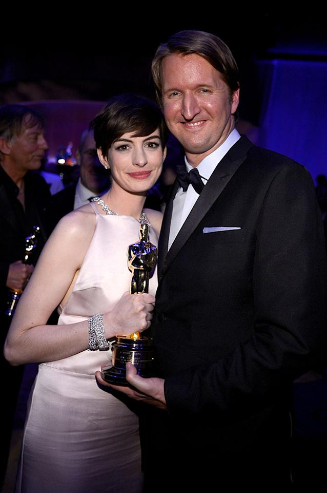 Anne Hathaway, winner of Best Actress award for her performance in 'Les Miserables' and director Tom Hooper attend the Oscars Governors Ball at Hollywood & Highland Center on February 24, 2013 in Hollywood, California.