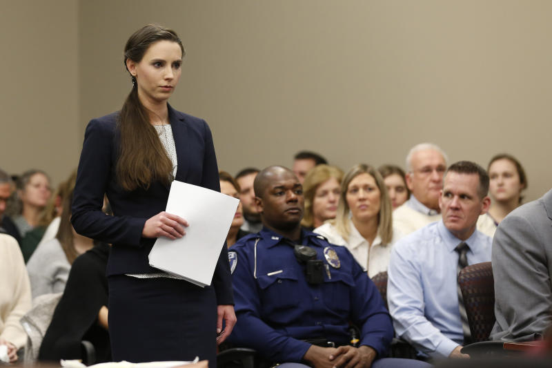 Rachael Denhollander speaks as former Michigan State University and USA Gymnastics doctor Larry Nassar listens to impact statements during the sentencing phase in Ingham County Circuit Court on January 24, 2018 in Lansing, Michigan. More than 100 women and girls accuse Nassar of a pattern of serial abuse dating back two decades, including the Olympic gold-medal winners Simone Biles, Aly Raisman, Gabby Douglas and McKayla Maroney -- who have lashed out at top sporting officials for failing to stop him. / AFP PHOTO / JEFF KOWALSKY (Photo credit should read JEFF KOWALSKY/AFP via Getty Images)