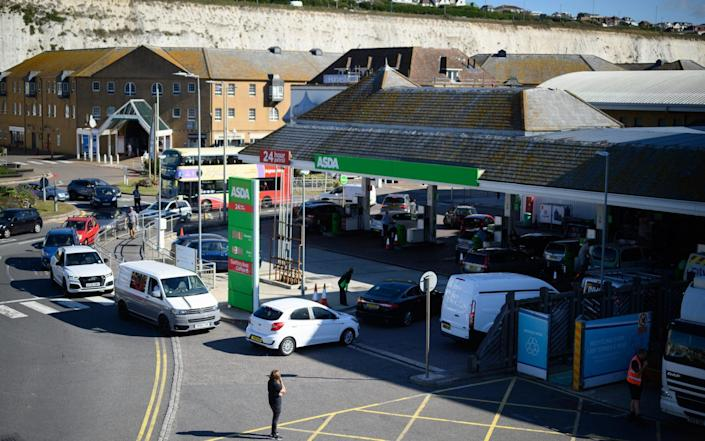 A man looks on as drivers queue to enter a supermarket petrol station as concern spreads over fuel supplies in Brighton, England - Leon Neal/Getty Images Europe