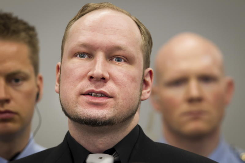 Defendant Anders Behring Breivik, centre, in court at the start of the 5th day of his mass killing trial in Oslo, Norway, Friday April 20, 2012. Confessed mass murderer Breivik testified Thursday in a chilling account of his preparations for the massacre of 77 people. (AP Photo / Heiko Junge, POOL)