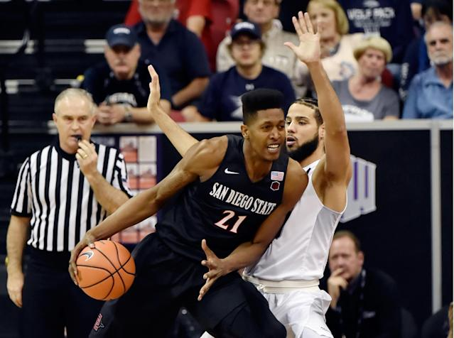 "LAS VEGAS, NV – MARCH 09: Malik Pope #21 of the San Diego State Aztecs drives the ball against Caleb Martin #10 of the <a class=""link rapid-noclick-resp"" href=""/ncaab/teams/nak/"" data-ylk=""slk:Nevada Wolf Pack"">Nevada Wolf Pack</a> during a semifinal game of the Mountain West Conference basketball tournament at the Thomas & Mack Center on March 9, 2018 in Las Vegas, Nevada. (Photo by David Becker/Getty Images)"