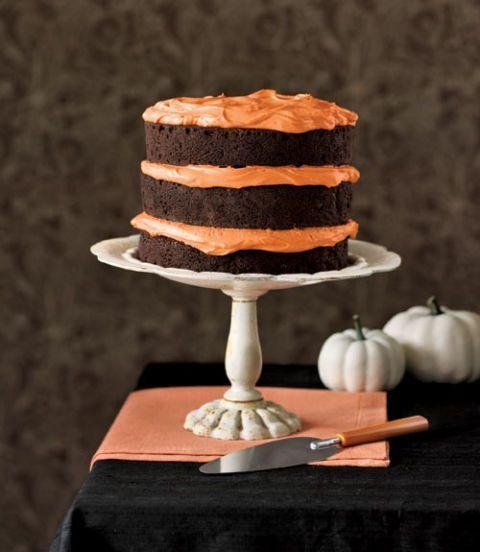 """<p>Less is more with this simply designed three-layer chocolate pumpkin spiced cake. While it may look reserved, the flavors will leave your tastebuds dancing.</p><p><em><a href=""""https://www.womansday.com/food-recipes/food-drinks/recipes/a13752/chocolate-pumpkin-cake-cupcakes-3922/"""" rel=""""nofollow noopener"""" target=""""_blank"""" data-ylk=""""slk:Get the recipe for Chocolate Pumpkin Cake"""" class=""""link rapid-noclick-resp"""">Get the recipe for Chocolate Pumpkin Cake</a>.</em></p>"""