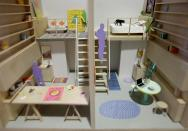 """A model of micro-apartments are displayed at an exhibit called """"Making Room: Models for Housing New Yorkers"""" at the Museum of the City of New York in New York, Tuesday, Jan. 15, 2013. The exhibit grew out of the city's PlaNYC, which projected the city's population will grow by about 600,000 people by 2030. (AP Photo/Seth Wenig)"""