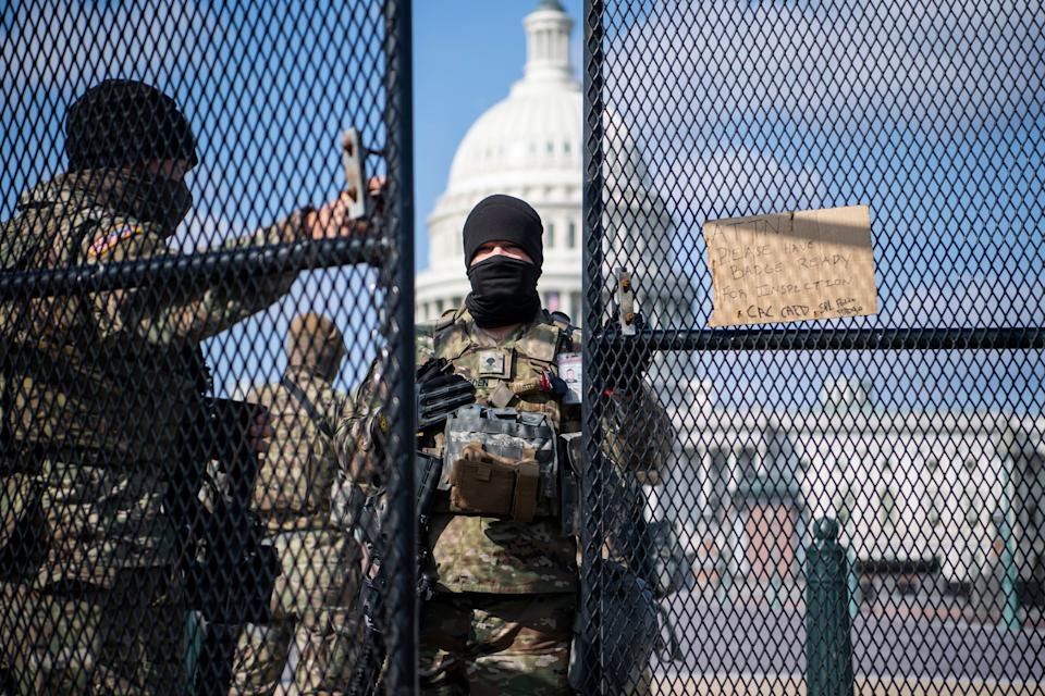 National Guard troops patrol the East Front of the Capitol on March 4, 2021. (Photo: Tom Williams via Getty Images)