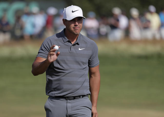 Brooks Koepka reacts after putting on the 12th green during the final round of the U.S. Open Golf Championship, Sunday, June 17, 2018, in Southampton, N.Y. (AP Photo/Julio Cortez)