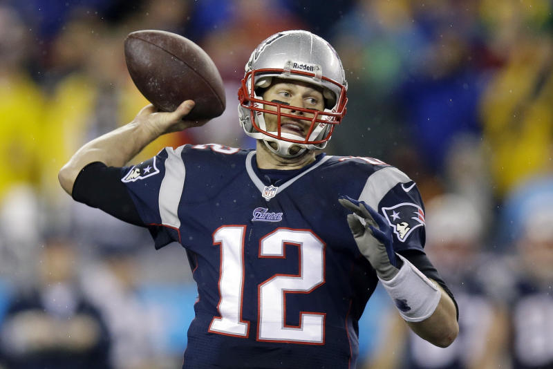 New England Patriots quarterback Tom Brady passes the ball during the second half of an AFC divisional NFL playoff football game against the Indianapolis Colts in Foxborough, Mass., Saturday, Jan. 11, 2014. (AP Photo/Stephan Savoia)