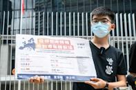 """Prominent democracy campaigner Joshua Wong tweeted the new law """"marks the end of Hong Kong that the world knew before. With sweeping powers and ill-defined law, the city will turn into a #secretpolicestate"""""""