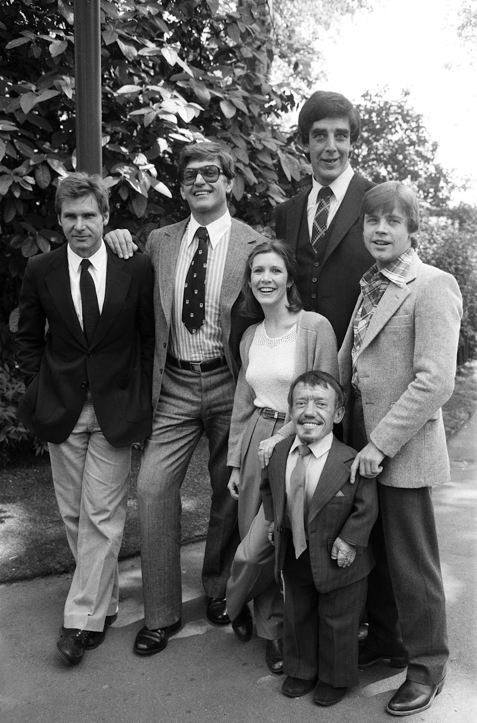 The stars of 'Star Wars: Episode V - The Empire Strikes Back' attend a photocall outside the Savoy Hotel, London, 19th May 1980. Left to right: Harrison Ford, David Prowse, Carrie Fisher, Kenny Baker, Peter Mayhew and Mark Hamill, 19th May 1980. (Photo by Alisdair MacDonald/Daily Mirror/Mirrorpix/Getty Images)Mirror/Mirrorpix/Getty Images)