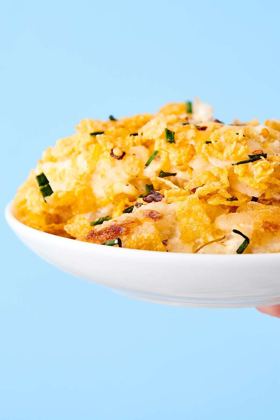 "<p>Forget the turkey! If you have a hash brown casserole that's as creamy, cheesy, and crunchy as this recipe, you'll forgo the main dish all together. We suggest adding extra Corn Flakes to really give it a kick. Since this recipe serves 12 people, we suggest dividing the ingredients by four so you can feed two people, plus have a little extra since it's just <em>that</em> good.</p> <p><strong>Get the recipe</strong>: <a href=""https://showmetheyummy.com/hashbrown-casserole/"" class=""link rapid-noclick-resp"" rel=""nofollow noopener"" target=""_blank"" data-ylk=""slk:hash brown casserole"">hash brown casserole</a></p>"