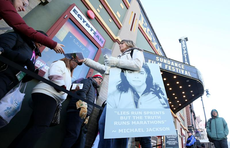 A protester hands out pamphlets to attendees at the documentary's premiere Friday at the Sundance Film Festival. (Photo: Danny Moloshok/Invision/AP)