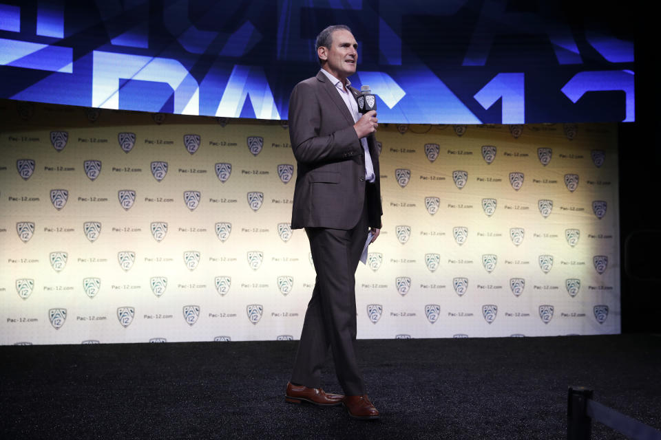 Pac-12 commissioner Larry Scott speaks at the Pac-12 Conference NCAA college football Media Day in Los Angeles, Wednesday, July 25, 2018. (AP Photo/Jae C. Hong)