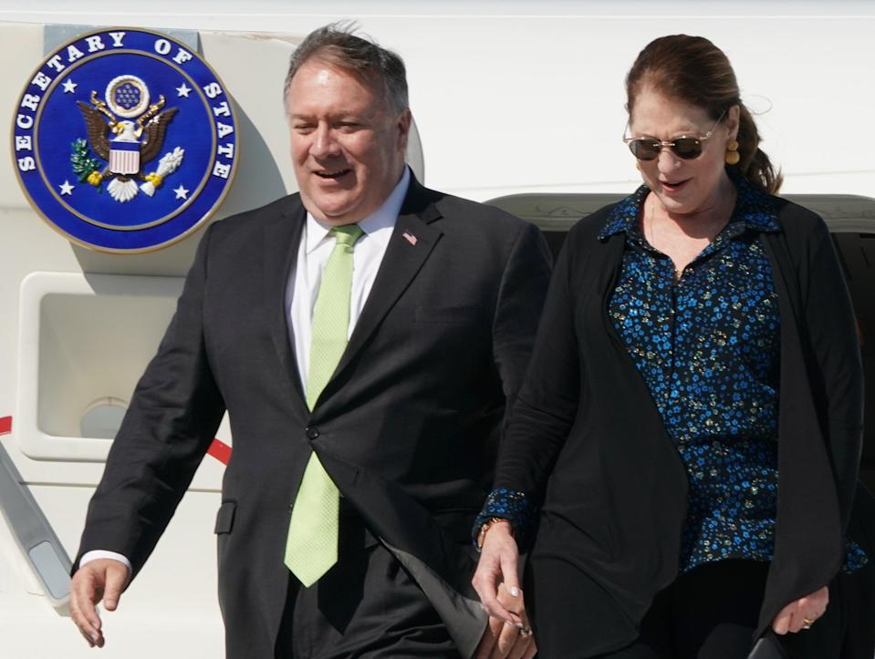 <p>US Secretary of State Mike Pompeo (L) and his wife Susan disembark their plane at Warsaw's Chopin airport as they arrive for a day visit to Poland, on August 15, 2020</p> (Photo by JANEK SKARZYNSKI/AFP via Getty Images)