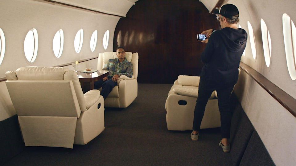 Creating a false online persona, Nick Bilton photographs Chris Bailey in a space designed to look like a private jet.