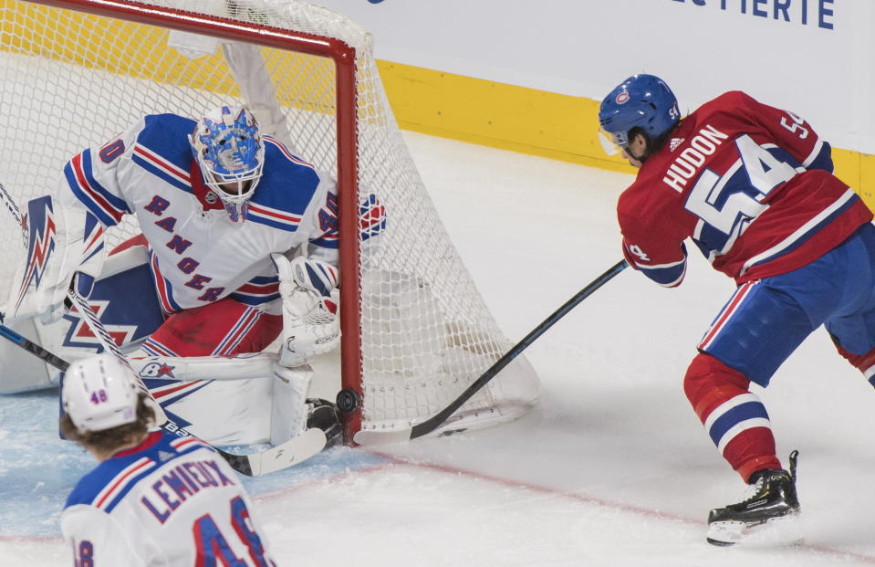 Montreal Canadiens' Charles Hudon (54) moves in on New York Rangers goaltender Alexandar Georgiev as Rangers' Brendan Lemieux defends during the second period of an NHL hockey game Saturday, Nov. 23, 2019, in Montreal. (Graham Hughes/The Canadian Press via AP)