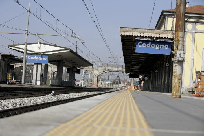 A view of the platform at the Codogno train station, near Lodi, Northern Italy, Saturday, Feb. 22, 2020. A dozen northern Italian towns were on effective lockdown Saturday after the new virus linked to China claimed two fatalities in Italy and sickened an increasing number of people who had no direct links to the origin of the virus. The secondary contagions prompted local authorities in towns in Lombardy and Veneto to order schools, businesses and restaurants closed, and to cancel sporting events and Masses. (AP Photo/Luca Bruno)