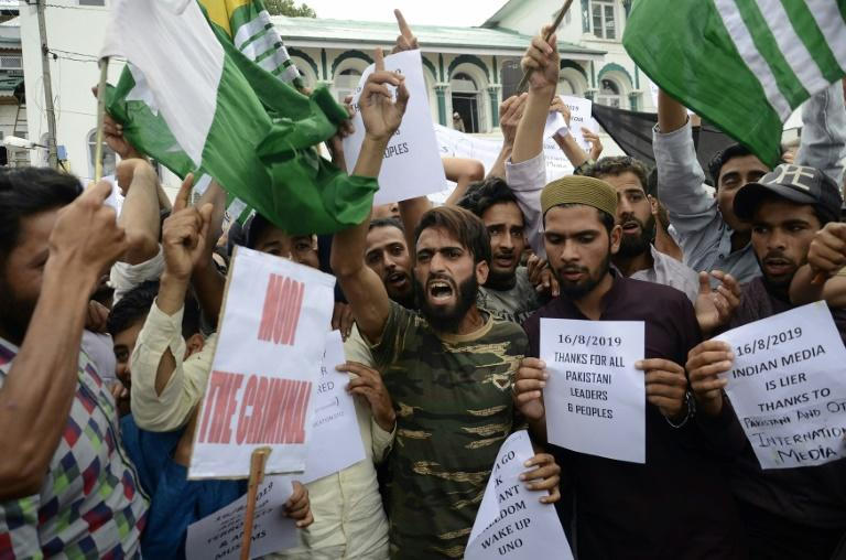 Protesters shout slogans at a rally in Srinagar against the Indian government's move to strip Jammu and Kashmir of its autonomy and impose a communications blackout