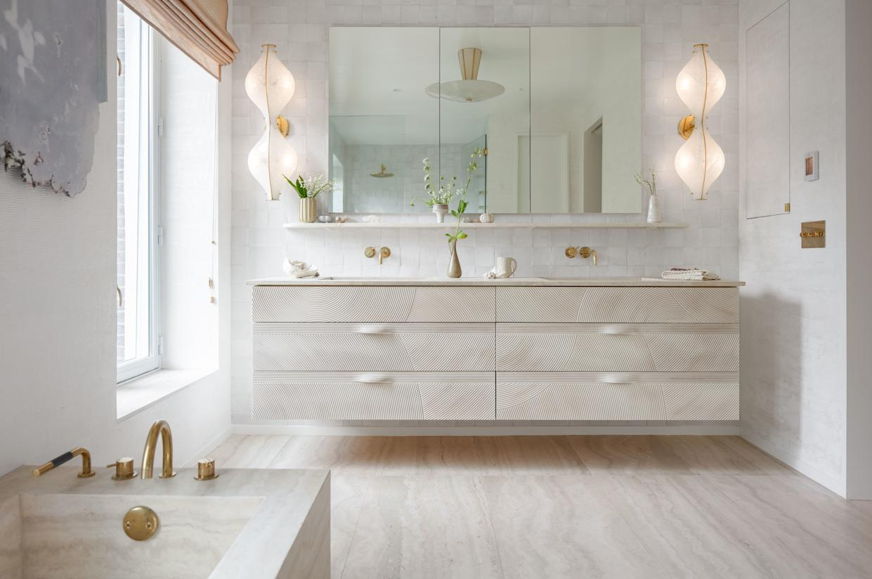 """<div class=""""caption""""> The custom vanity is paneled with whitewashed maple. </div>"""