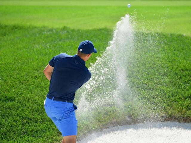 Jordan Speith perfects his bunker shot at the Bellerive Country Club (Getty)