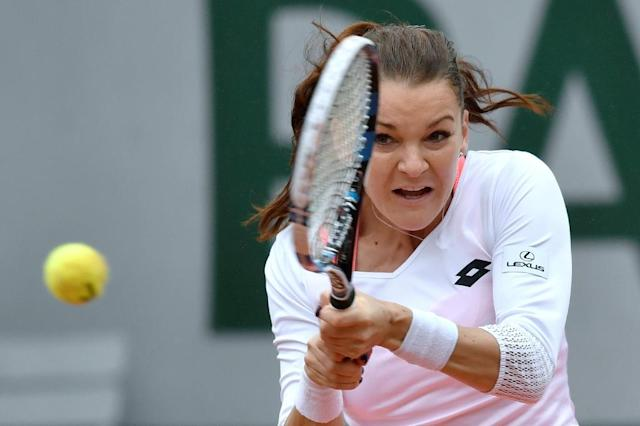 Poland's Agnieszka Radwanska (pictured) lost 2-6, 6-3, 6-3 to Bulgaria's Tsvetana Pironkova in the fourth round of the French Open in Paris on May 31, 2016 (AFP Photo/Philippe Lopez )