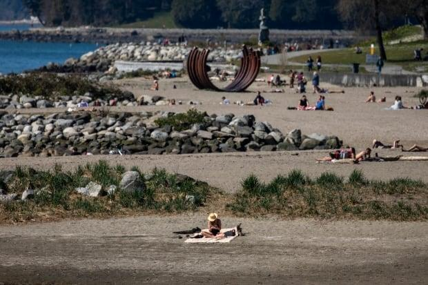 People are pictured enjoying the sunshine at Sunset Beach in Vancouver on Thursday.  (Ben Nelms/CBC - image credit)