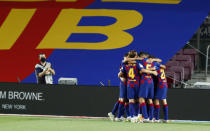 Barcelona's Luis Suarez celebrates with teammates scoring the opening goal during the Spanish La Liga soccer match between FC Barcelona and RCD Espanyol at the Camp Nou stadium in Barcelona, Spain, Wednesday, July 8, 2020. (AP Photo/Joan Monfort)