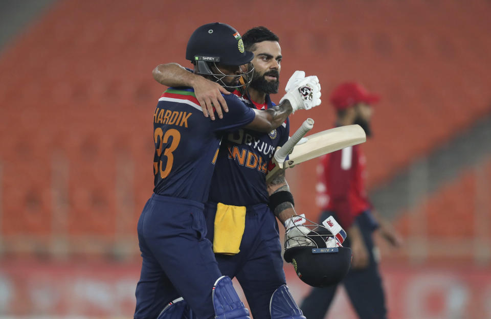 India's captain Virat Kohli, right, and teammate Hardik Pandya celebrate at the end of their innings during the fifth Twenty20 cricket match between India and England at Narendra Modi Stadium in Ahmedabad, India, Saturday, March 20, 2021. (AP Photo/Ajit Solanki)
