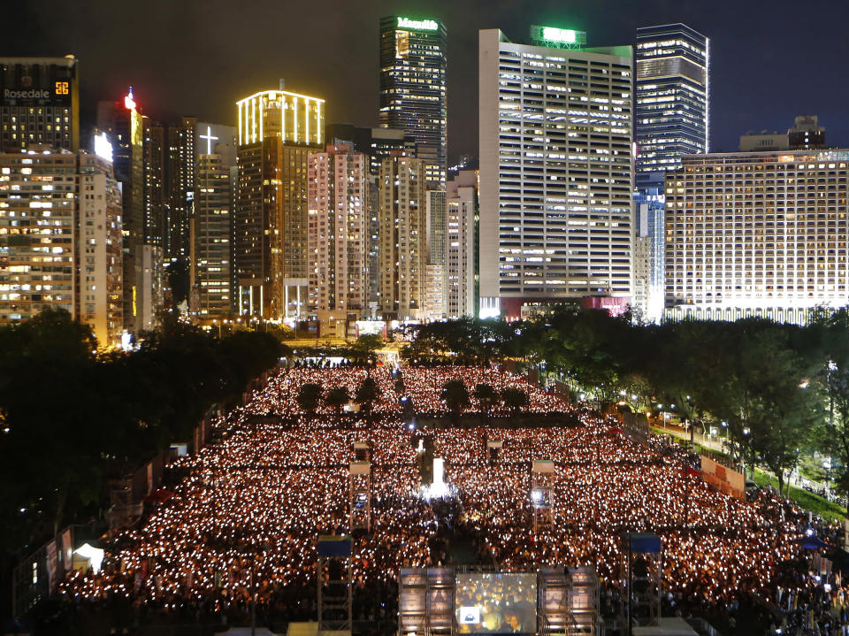 FILE - In this June 4, 2015, file photo, thousands of people attend a candlelight vigil in Hong Kong's Victoria Park to mark the anniversary of the military crackdown on a pro-democracy student movement in Beijing. (AP Photo/Kin Cheung, File)