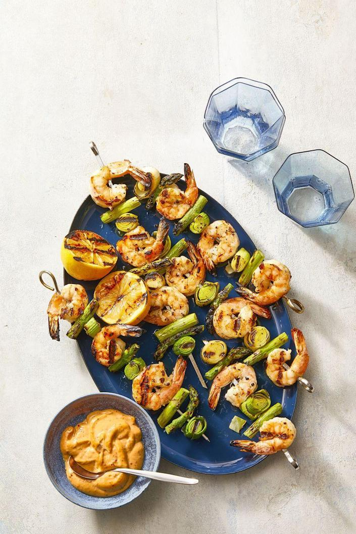 """<p>These easy shrimp skewers make the perfect weeknight dinner.</p><p><a href=""""https://www.womansday.com/food-recipes/a36040238/charred-shrimp-leek-and-asparagus-skewers-recipe/"""" rel=""""nofollow noopener"""" target=""""_blank"""" data-ylk=""""slk:Get the Charred Shrimp, Leek, and Asparagus Skewers recipe."""" class=""""link rapid-noclick-resp""""><em>Get the Charred Shrimp, Leek, and Asparagus Skewers recipe.</em></a></p>"""