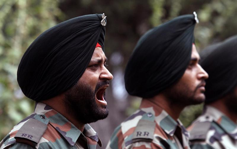 An Indian army officer shouts near the war memorial during the Kargil Vijay Diwas, or Kargil Victory Day, in Srinagar, India, Thursday, July 26, 2012. Thursday marks the second day of the two-day celebrations of the 13th anniversary of its victory in the Kargil conflict, the 1999 conflict with Pakistan that raged for three months across the disputed Kashmir region had nearly brought the nuclear neighbors to a war. (AP Photo/Mukhtar Khan)