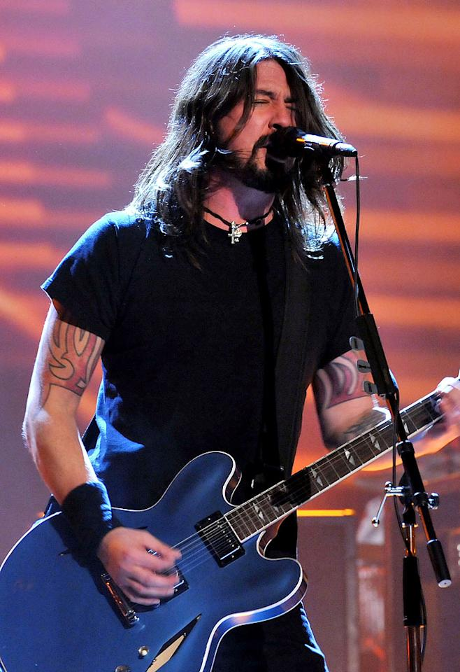 "Dave Grohl of the <a href=""/foo-fighters/contributor/91055"">Foo Fighters</a> — ""Most recently, I tattooed these feathers on Dave Grohl's forearms, from Foo Fighters. And he's just, over the years, become a really good friend, and tattooing him is like a bonding thing for us. It was fun, aesthetically; they were, like, raven feathers on his forearms, and it was just a very beautiful design. He'd been wanting to get tattooed ever since we first met, years ago. And then finally, before he went on this last tour, he's like, 'I want to make an appointment.' So he came in. I just think he likes what it looks like. I don't think there's a profound meaning. I just think it's beautiful."""