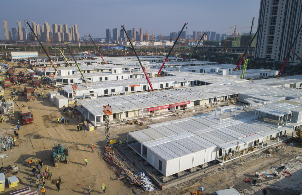 In this Feb. 4, 2020, photo released by China's Xinhua News Agency, construction workers labor at the Leishenshan Hospital, the second temporary field hospital being built in Wuhan in central China's Hubei Province. Deaths from a new virus rose to 490 in mainland China on Wednesday while new cases on a Japanese cruise ship, in Hong Kong and in other places showed the increasing spread of the outbreak and renewed attention toward containing it. (Xiao Yijiu/Xinhua via AP)