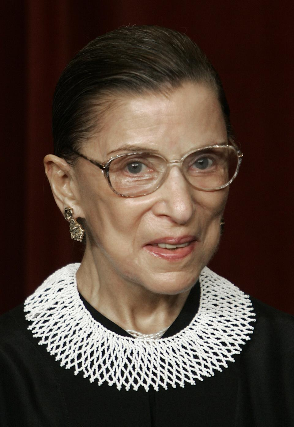 US Supreme Court Justice Ruth Bader Ginsburg looks at the camera as the justices pose for their class photo 03 March 2006 inside the Supreme Court in Washington, DC.     AFP PHOTO/Paul J. RICHARDS (Photo by Paul J. RICHARDS / AFP) (Photo by PAUL J. RICHARDS/AFP via Getty Images)
