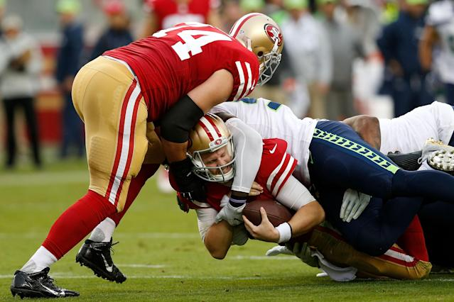 <p>C.J. Beathard #3 of the San Francisco 49ers is tackled by Frank Clark #75 of the Seattle Seahawks at Levi's Stadium on November 26, 2017 in Santa Clara, California. (Photo by Lachlan Cunningham/Getty Images) </p>