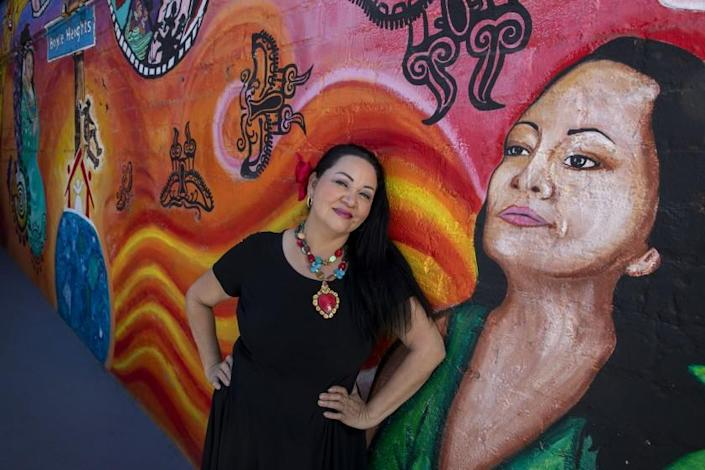 BOYLE HEIGHTS, CA - JULY 31, 2021- Founding artistic director Josefina Lopez sits for portraits outside the theatre with a mural of herself at Casa 0101 Saturday, July 31, 2021 in Boyle Heights, CA. (Brian van der Brug / Los Angeles Times)