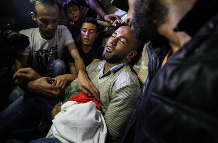 <p>Palestinians mourn over the body of eight-month-old Palestinian baby Leila Anwar Ghandoour, died from tear gas inhalation during clashes in Gaza the previous day, during her funeral in Gaza City on May 15, 2018. (Photo: Mustafa Hassona/Anadolu Agency/Getty Images) </p>