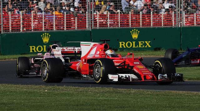 MELBOURNE, Australia (AP) Sebastian Vettel jumped onto the podium at the Australian Grand Prix and held up his right index finger, celebrating the end of Ferrari's Formula One drought and a break in the Mercedes dominance.