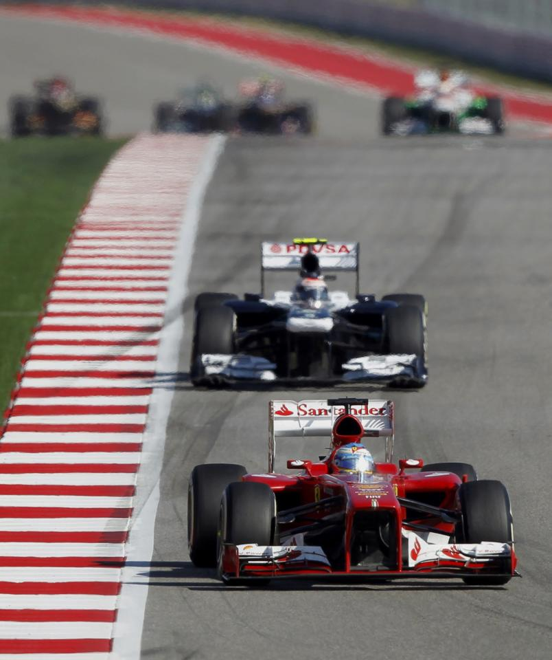 Ferrari Formula One driver Fernando Alonso of Spain (front) drives ahead of Williams Formula One driver Valtteri Bottas of Finland during the Austin F1 Grand Prix at the Circuit of the Americas in Austin November 17, 2013. REUTERS/Mike Stone (UNITED STATES - Tags: SPORT MOTORSPORT F1)