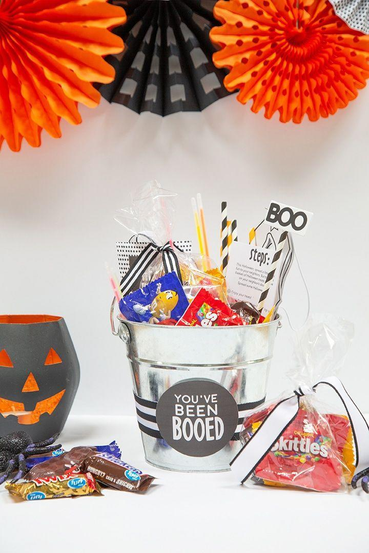 """<p>In some neighborhoods and friend groups, it's a tradition to make a spooky basket to send on to others with a note that says, """"You've been booed."""" This one comes with printable instructions about how to pass it on.</p><p><a href=""""https://www.aliceandlois.com/halloween-boo-basket-tradition/"""" rel=""""nofollow noopener"""" target=""""_blank"""" data-ylk=""""slk:See more at Alice & Lois »"""" class=""""link rapid-noclick-resp""""><em>See more at Alice & Lois » </em></a></p>"""