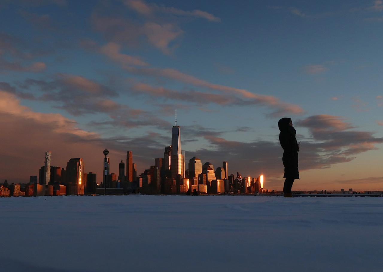 <p>The skyline of lower Manhattan is shown at sunset from Hoboken, N.J., as a winter storm retreats from the area, Feb. 9, 2017. A powerful, fast-moving storm swept through the northeastern U.S. Thursday, making for a slippery morning commute and leaving some residents bracing for blizzard conditions. (Photo: Gary Hershorn/Getty Images) </p>