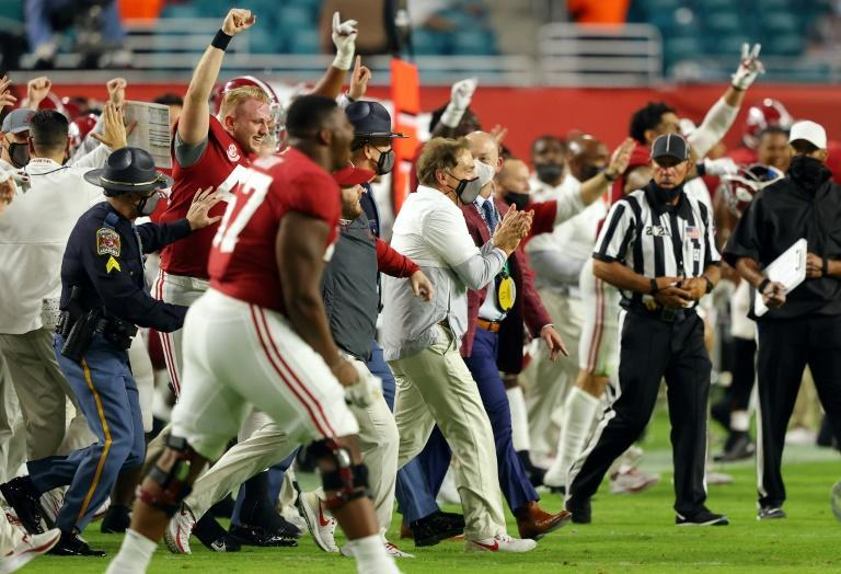 University of Alabama coach Nick Saban celebrates with Crimson Tide players after defeating the Ohio State Buckeyes in the 2020 College Football Playoff national championship game