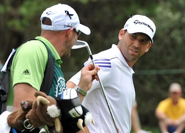 Spain's Sergio Garcia, right, on the 1st fairway during the third day of play at Sun City South Africa, Saturday, Dec 7, 2013. Garcia is joint 3rd (AP Photo)