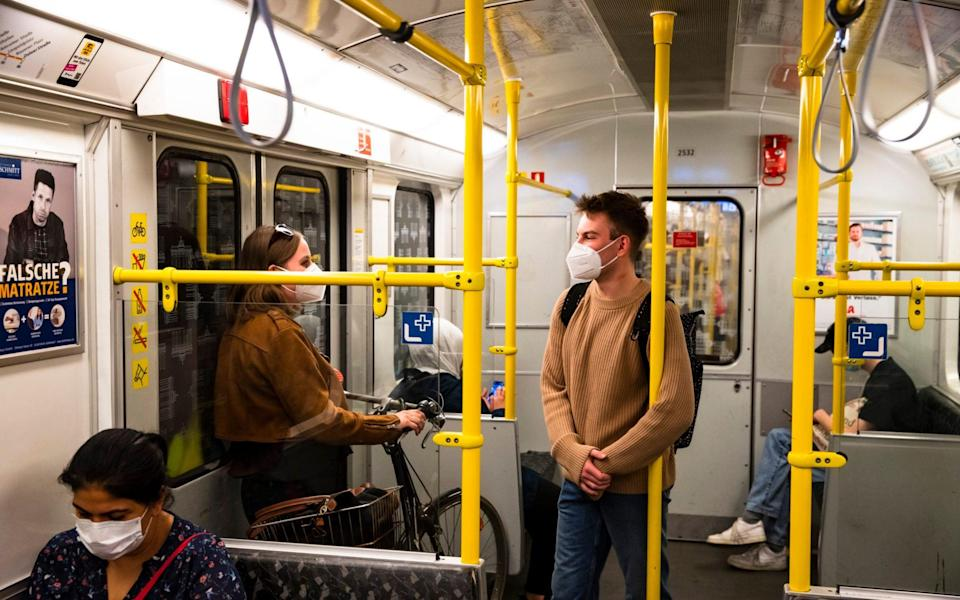 Face masks are mandatory on public transport in Berlin, as this picture shows - but footage (now taken down) of illegal 'corona parties' showed something altogether different - NurPhoto