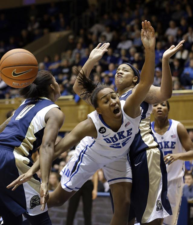 Duke's Oderah Chidom drives between Pittsburgh's Asia Logan (0) and Cora McManus, right, during the first half of an NCAA college basketball game in Durham, N.C., Sunday, Jan. 26, 2014. (AP Photo/Gerry Broome)