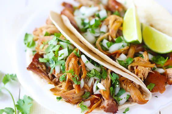 "<strong>Get the <a href=""http://www.gimmesomeoven.com/crispy-slow-cooker-carnitas/"" rel=""nofollow noopener"" target=""_blank"" data-ylk=""slk:crispy slow cooker carnitas recipe"" class=""link rapid-noclick-resp"">crispy slow cooker carnitas recipe</a> by Gimme Some Oven.</strong>"