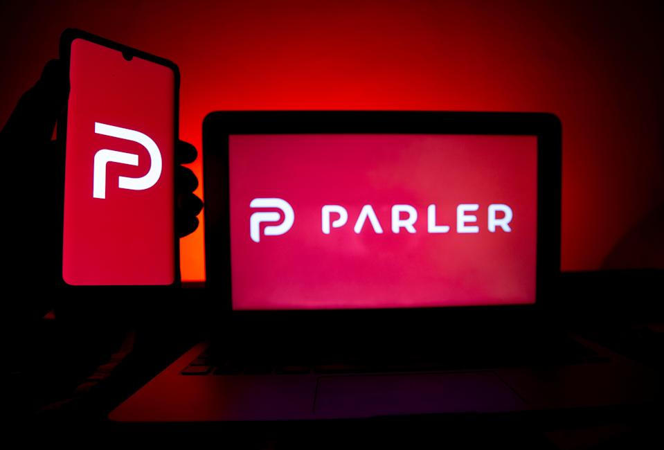 A photo illustration shows the logo of Conservative social media application (app) Parler on a computer and mobile telephone screen, in Paris, France, on 11 January 2021 ((EPA))
