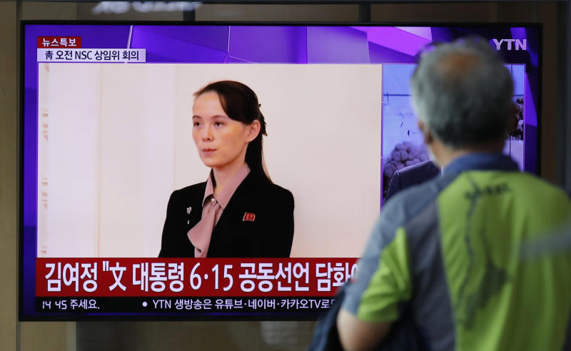 A man watches a TV screen showing a news program with a file image of Kim Yo Jong, the sister of North Korea's leader Kim Jong Un, at the Seoul Railway Station in Seoul, South Korea, Wednesday, June 17, 2020. North Korea said Wednesday that it will send soldiers to now-shuttered inter-Korean cooperation sites in its territory and reinstall guard posts and resume military exercises at front-line areas, nullifying tension-reducing deals reached with South Korea just two years ago. (AP Photo/Lee Jin-man)