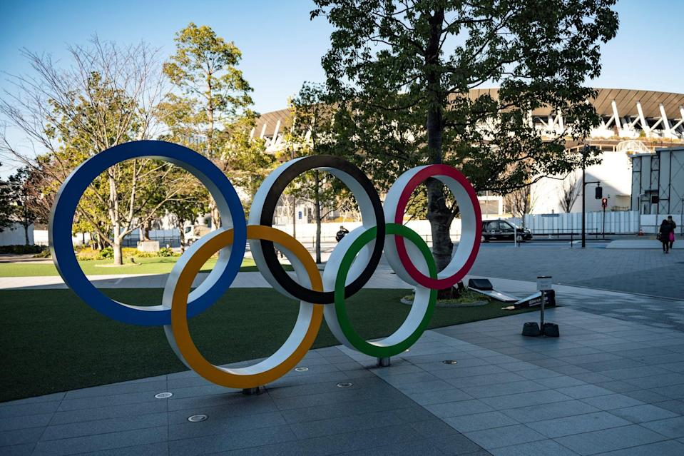 This picture taken on January 20, 2021 shows the Olympic rings outside the Olympic Museum in Tokyo. - When the Tokyo Olympics were postponed last year, officials promised they would open in 2021 as proof of humankind's triumph over the coronavirus. But six months before the delayed start, victory over the virus remains distant, and fears are growing rapidly that the Games of the 32nd Olympiad may not happen at all. (Photo by Philip FONG / AFP) / TO GO WITH AFP STORY OLY-2020-2021-JAPAN-VIRUS-HEALTH BY ANDREW MCKIRDY (Photo by PHILIP FONG/AFP via Getty Images)