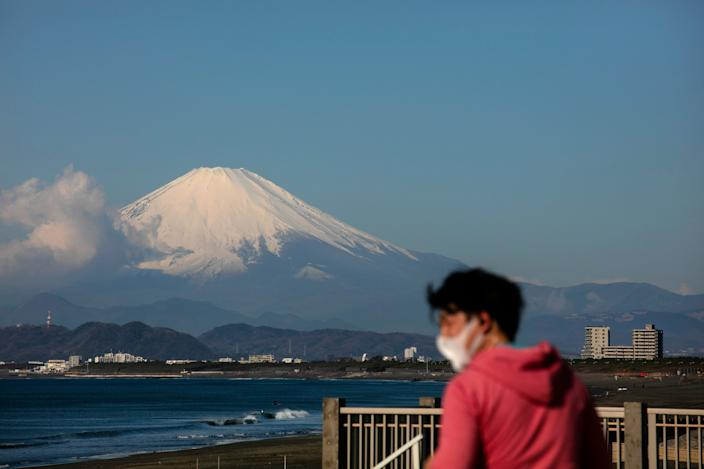 A man visiting a beach in Fujisawa, Japan, on Thursday.